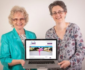 June and Helen holding latop with new website